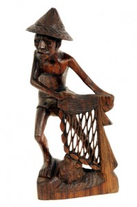 An intricately hand carved wooden fisherman from Bali - 0106